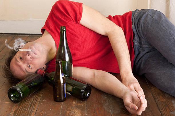man drinking and smoking stock photo