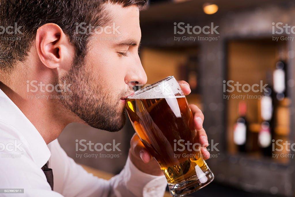 Man drinking beer. stock photo