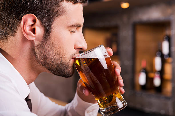 Man drinking beer. stock photo