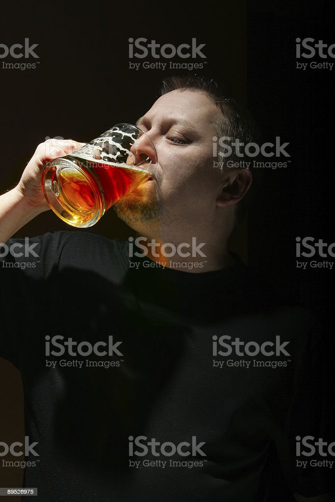 Man drinking beer royalty-free stock photo