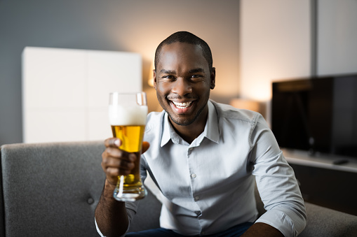 Man Drinking Beverage Beer In Video Conference