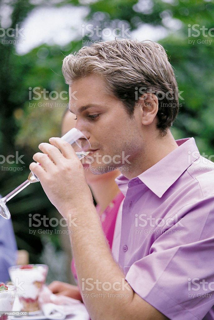 Man drinking champagne royalty-free stock photo