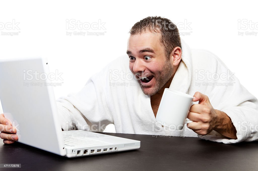 Man drinking Coffee and using a Computer royalty-free stock photo