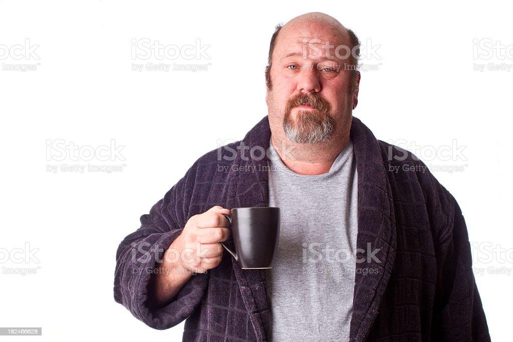 Man Drinking Coffee in Robe stock photo