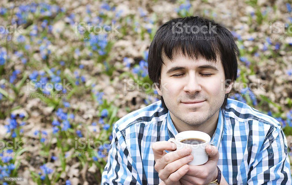 Man drinking coffee outdoor. Enjoyment royalty-free stock photo