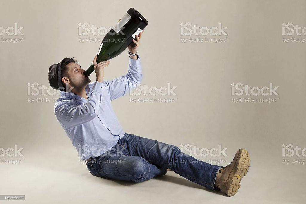 Man drinking from extremely big bottle stock photo