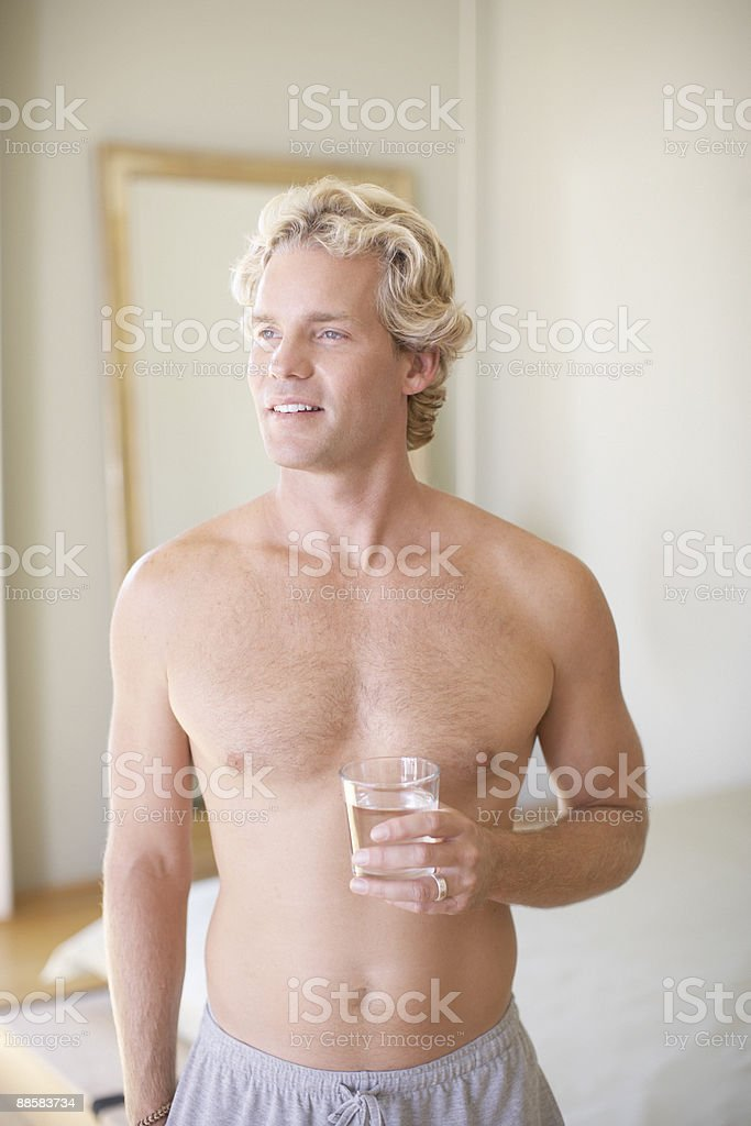 Man drinking glass of water at home royalty-free stock photo