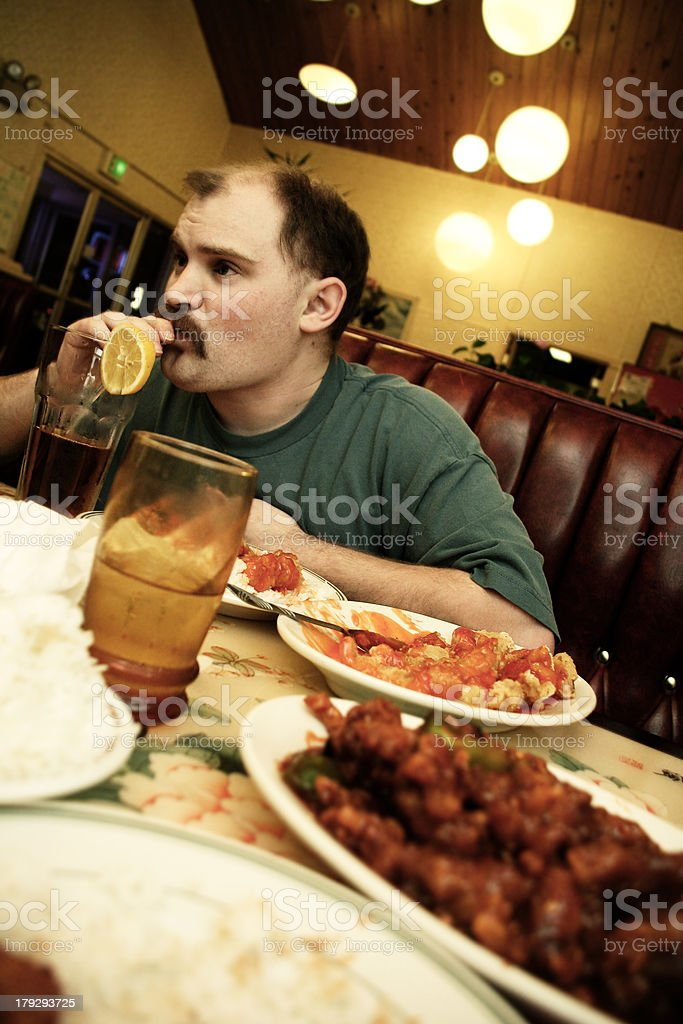 Man Drinking Iced Tea at Chinese Restaurant royalty-free stock photo
