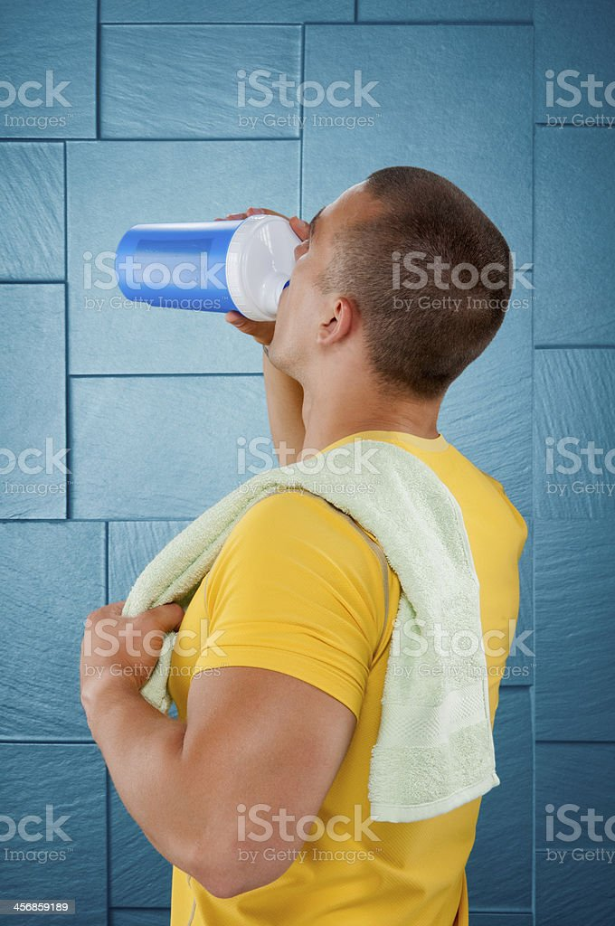 Man drinking protein shake royalty-free stock photo