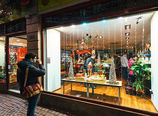 Man drinking tea front of Tea store tea shop christmas stock photo