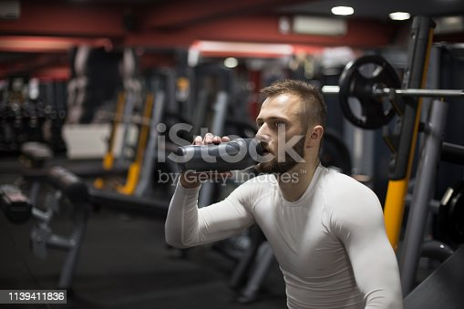 istock Man drinking water after exercise 1139411836