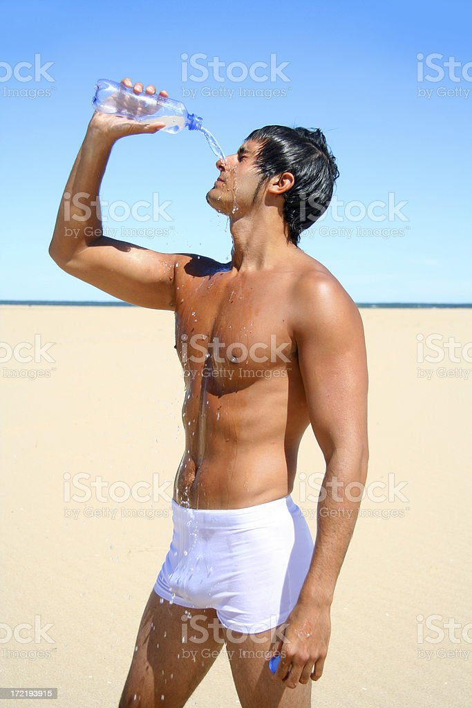Man Drinking Water on the Beach royalty-free stock photo