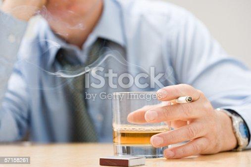 istock Man drinking whisky and smoking 57158261