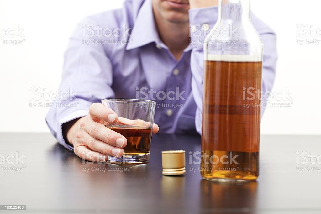 Man drinking whisky royalty-free stock photo