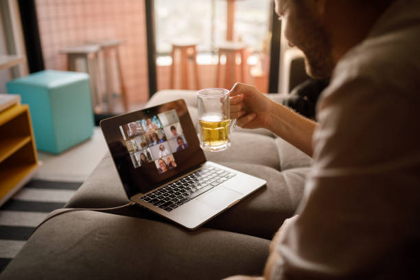 Man drinking with friends on social distance stock photo