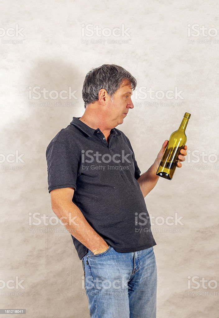man drinks alcohol out of a bottle royalty-free stock photo