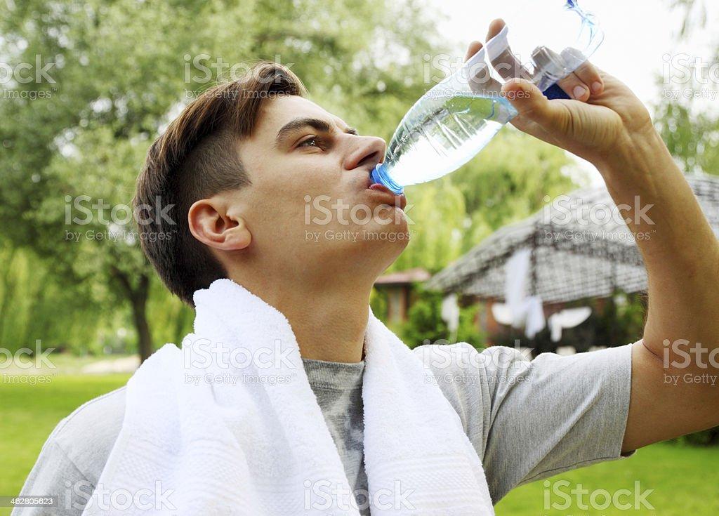 man drinks stock photo