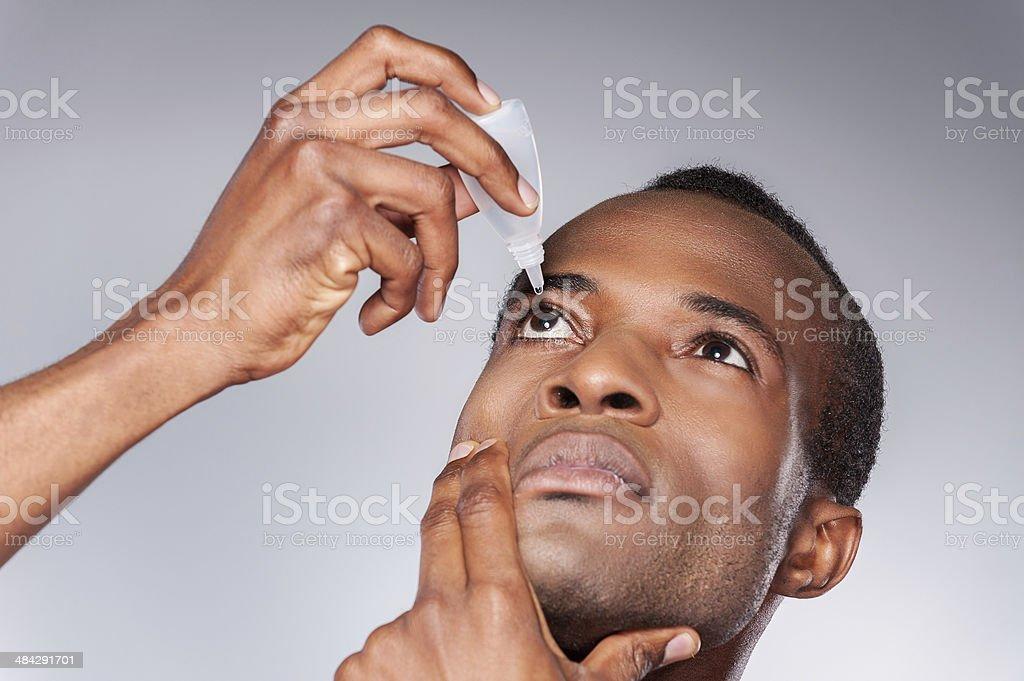 Man dripping eye. stock photo