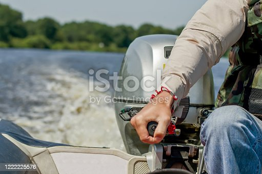 175421347 istock photo A man drives a motor boat. Speed boat. 1222225576