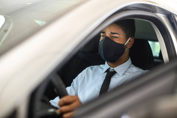 Man driving a car during the pandemic stock photo