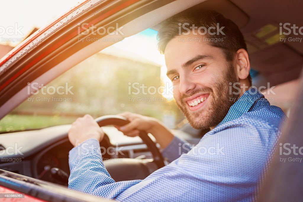 Man driving a car stock photo