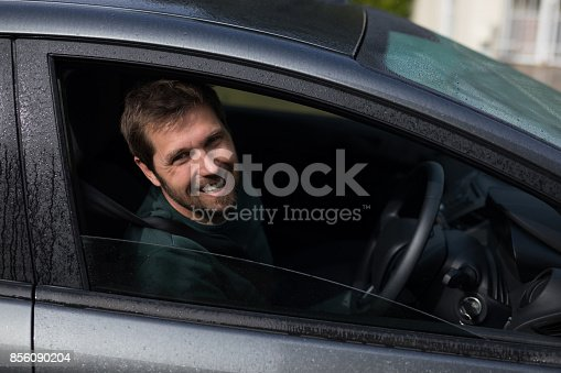1051147634 istock photo Man driving a car 856090204