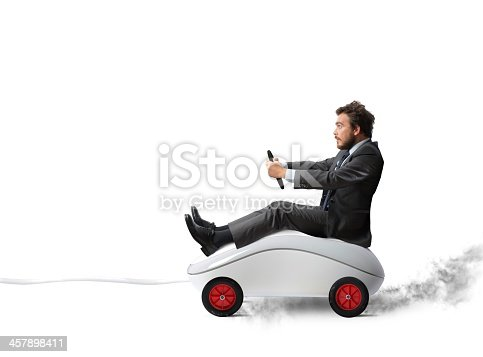 istock A man driving a computer mouse that has been turned to a car 457898411
