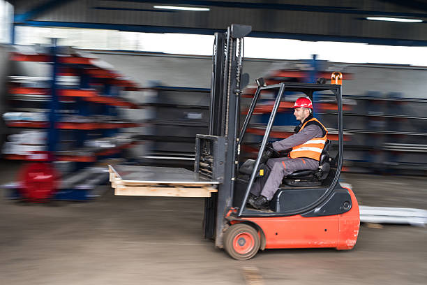 Man driving a forklift in blurred motion. stock photo