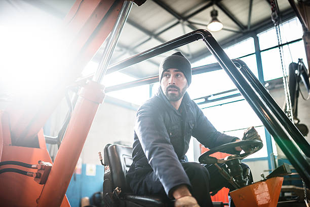 man driving a forklift man driving a forklift  pallet jack stock pictures, royalty-free photos & images