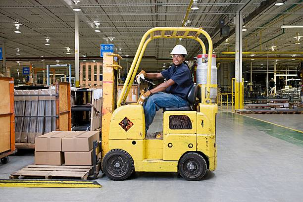 Man driving a forklift truck stock photo