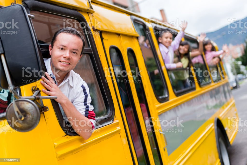 Man driving a school bus stock photo
