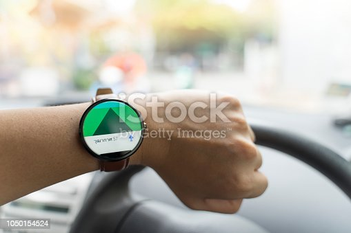 istock Man driving and using smart watch gps navigator map 1050154524