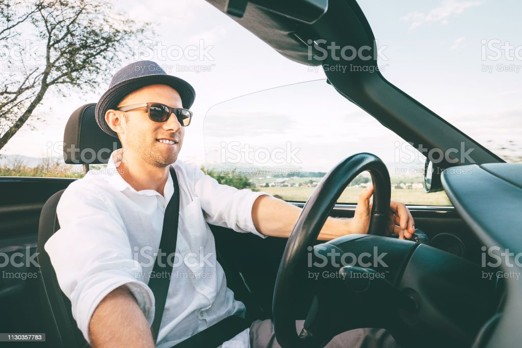 Man driving cabriolet car by province mountain road inside car view