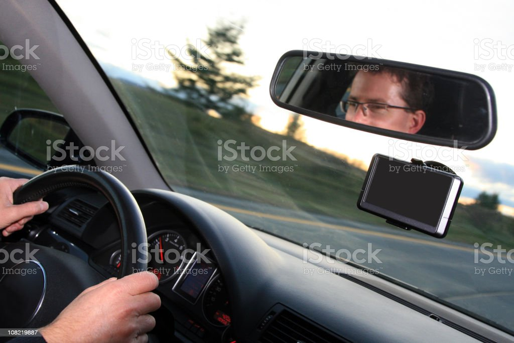 Man Driving Car Down Road with GPS Navigation Installed royalty-free stock photo