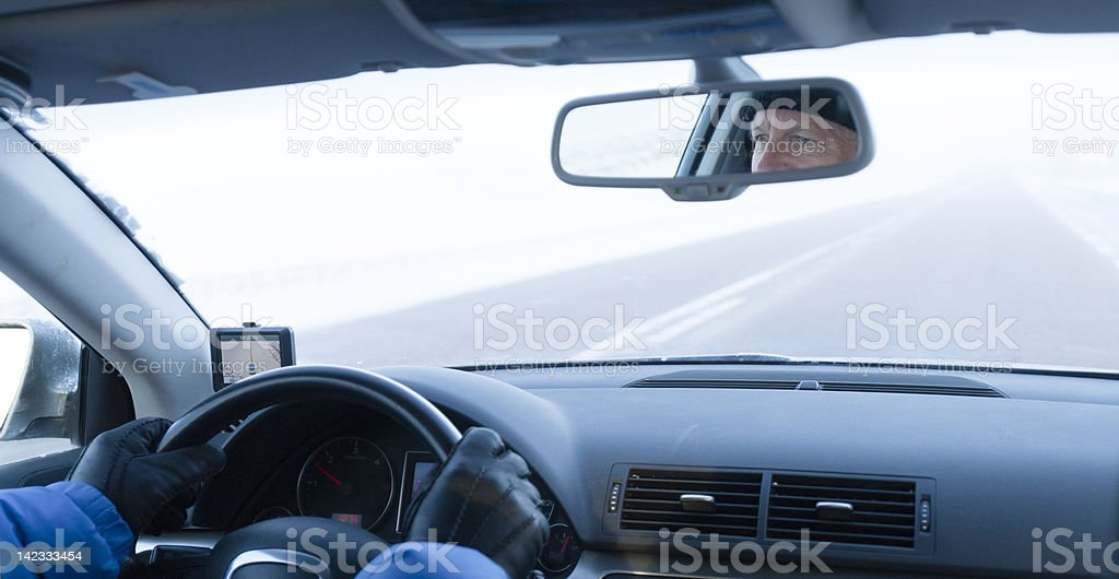 Man driving car in winter stock photo