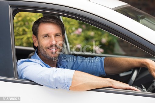 1051147634 istock photo Man driving car 528288976