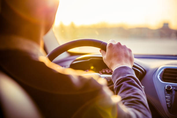man driving car - car interior stock photos and pictures