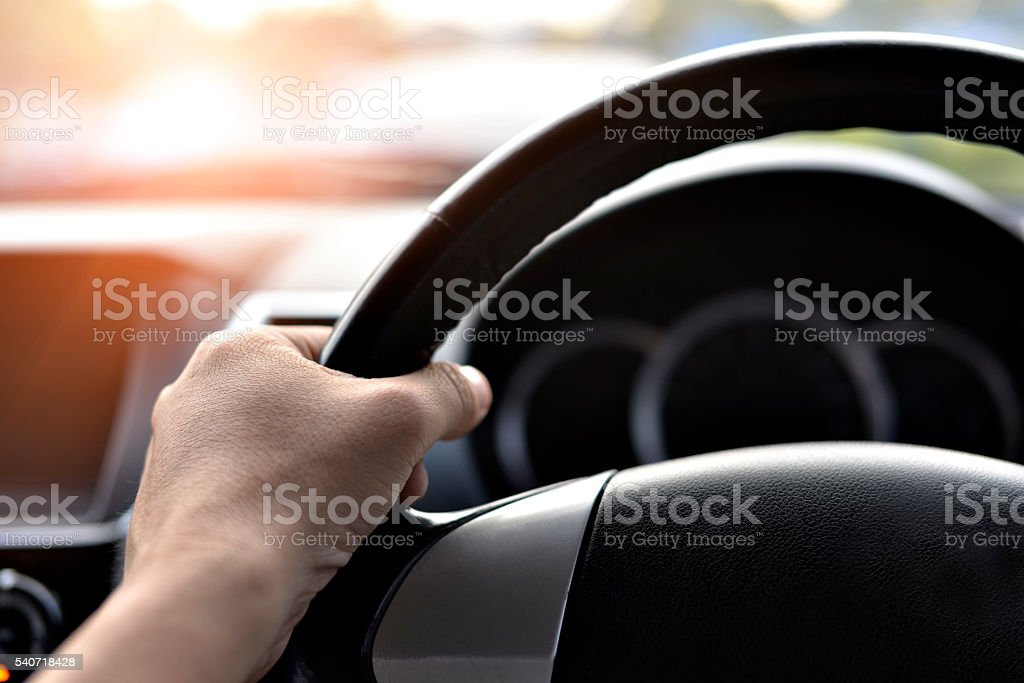 Man driving car. Ray light added. stock photo