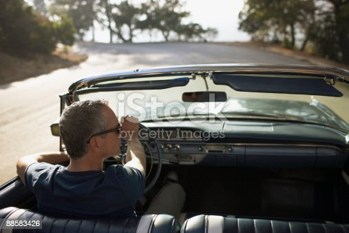 istock Man driving convertible car 88583426