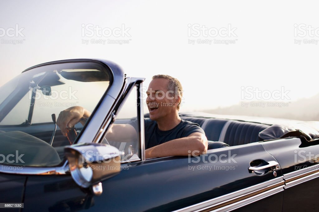 Man driving convertible stock photo