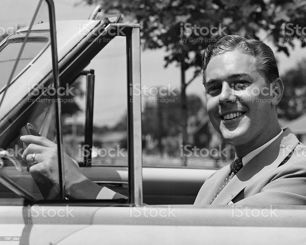 Man driving convertible royalty free stockfoto