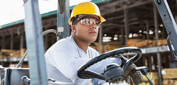 Man driving forklift stock photo
