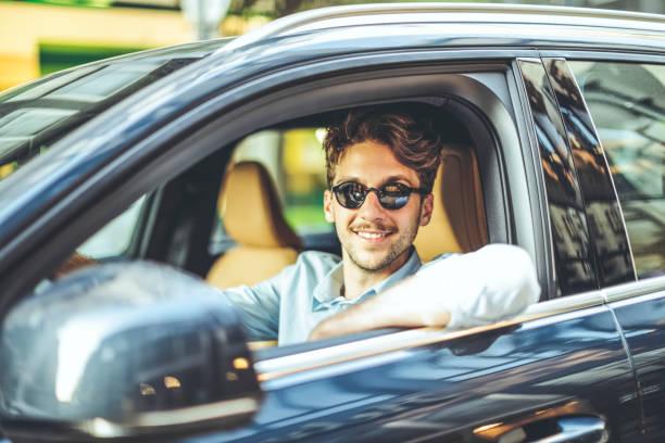Man driving his car stock photo