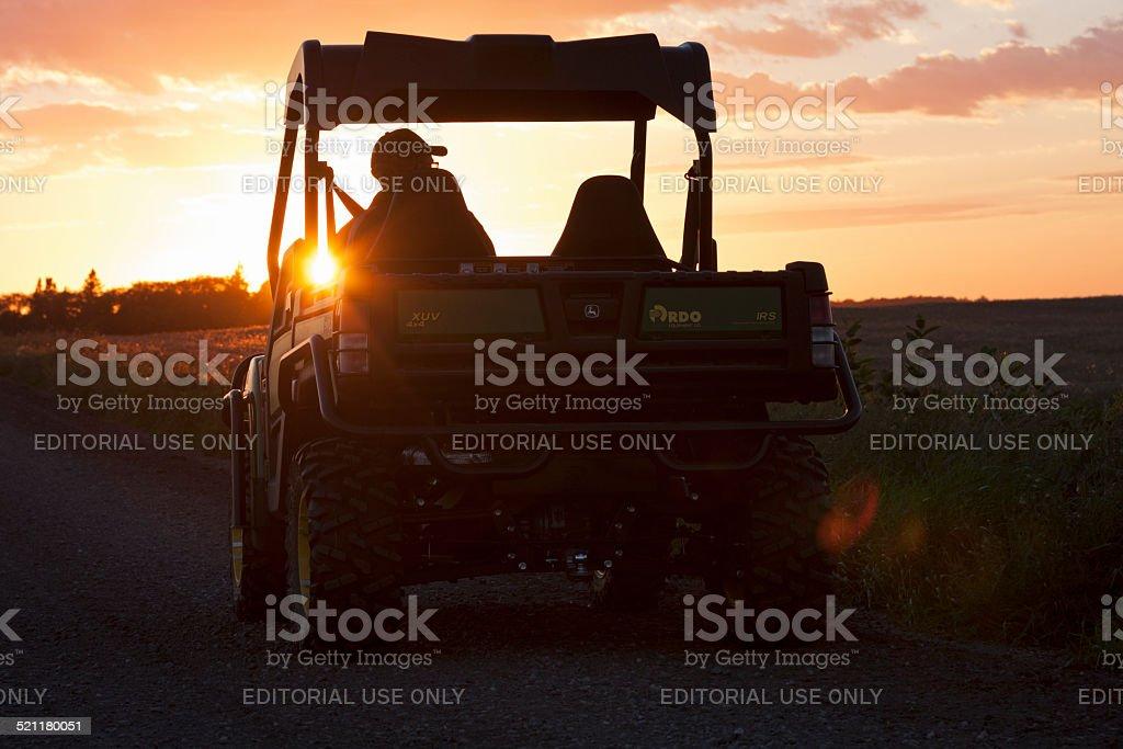 Man Driving John Deere 4x4 Gator XUV stock photo