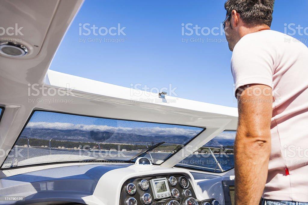 Man driving motorboat royalty-free stock photo