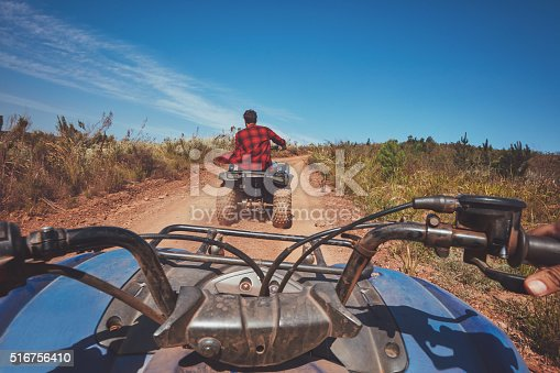 istock Man driving off road on an ATV 516756410