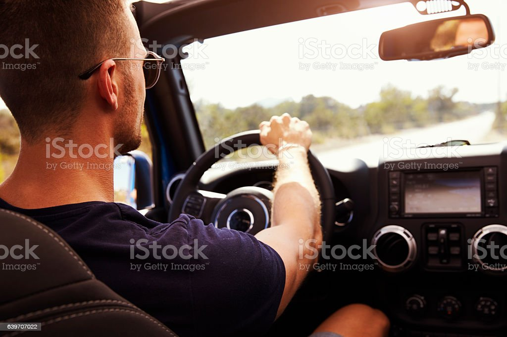 Man Driving Open Top Car On Country Road stock photo