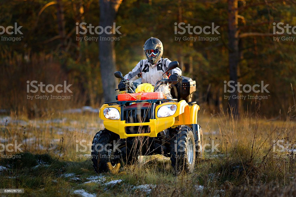 Man driving quad bike stock photo