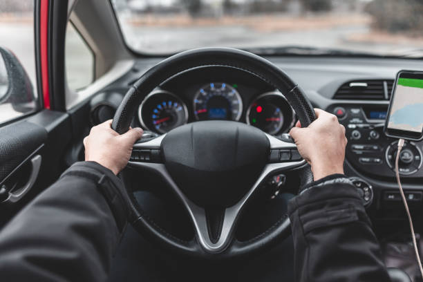 Man driving safely inside the car stock photo