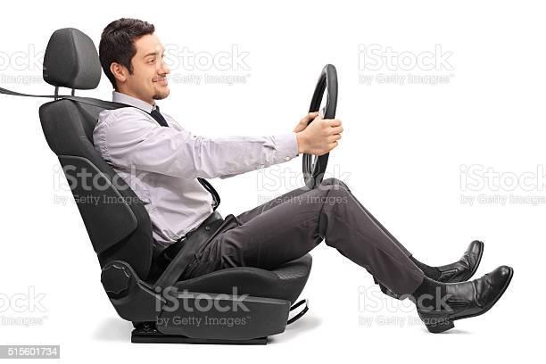 Man driving seated on a car seat picture id515601734?b=1&k=6&m=515601734&s=612x612&h=ptfp07pi3kostu7aqk5o3qgarzzboszihzrffllibna=